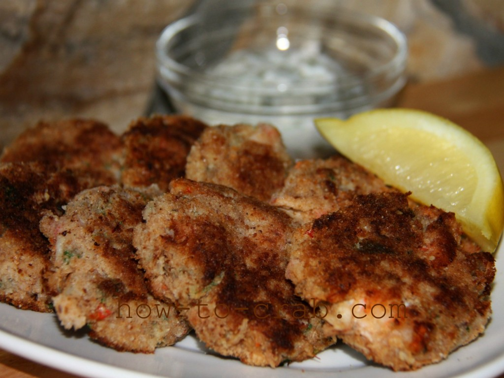 A plate of bready crab cakes with mild spice.