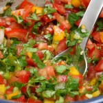 A mild spicy salsa with red and green peppers for crab cakes.