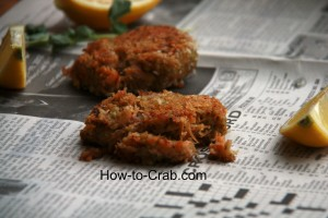 Simple and delicious fried crab cakes on newspaper